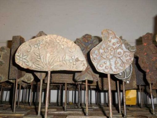 Antique wooden fabric stamps on stand-4