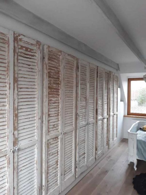 Fitted wardrobe in bedroom of antique louvre blinds / shutters-4